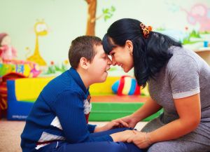 mother and her beloved son with disability in rehabilitation center
